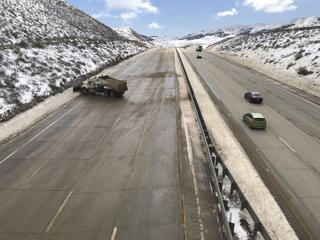 In this Feb. 18, 2019 photo released by the California Highway Patrol, CHP Central Division shows crews clearing the last of the ice, before the Northbound Interstate 5 is about to open to traffic over Grapevine, Calif. Two major Southern California highways were reopened Monday, Feb. 18, 2019, after ice and blowing snow forced closures that stranded hundreds of motorists, including some who spent a frigid night in their vehicles.