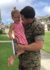 Marine dad surprises daughter by coming home gift-wrapped in box