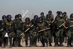 US Border Patrol, Immigration and Customs Enforcement (ICE) and Customs and Border Protection (CBP) agents take part in a safety drill in the Anapra area in Sunland Park, New Mexico, United States, across from Ciudad Juarez, Chihuahua state, Mexico, on January 31, 2019. (Photo by Herika Martinez / AFP)        (Photo credit should read HERIKA MARTINEZ/AFP/Getty Images)
