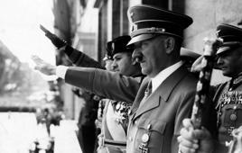 Adolf Hitler and Count Ciano salute on a chancellory balcony in Berlin. Hitler was chancellor of Germany from 1933 to 1945 and dictator of Nazi Germany from 1934 to 1945. Hitler was at the centre of Nazi Germany, World War II in Europe, and the Holocaust. (Photo by: Photo12/UIG via Getty Images)