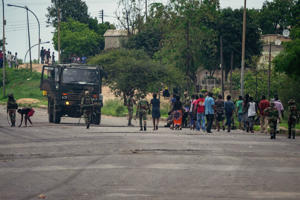Zimbabwean soldiers allegedly make residents clean off barricades following recent protests in Sizinda township, Bulawayo, on January 16, 2019.