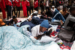 A student from the University of the Witwatersrand (WITS) lies on the ground reading a document during a hunger strike at the Solomon Mahlangu House on February 5, 2019 on Johannesburg, as they demand that homeless students should be provided with adequate accommodation and students who have historical debts be allowed to register at the university.