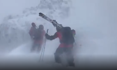 Ski patrollers battle fierce winds during avalanche control work