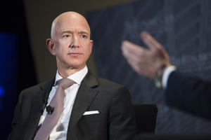 Jeff Bezos, Amazon founder and CEO, speaks at The Economic Club of Washington's Milestone Celebration in Washington, Thursday, Sept. 13, 2018. Bezos said that he is giving $2 billion to start the Bezos Day One Fund which will open preschools in low-income neighborhoods and give money to nonprofits that helps homeless families. (AP Photo/Cliff Owen)