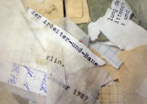 Torn Stasi files are visible in a sack of hitherto undocumented material at the Stasi archives in Berlin, Germany, 17 January 2015. On the occasion of the 25th anniversary of the storming of the Stasi headquarters, interested people can participate in a citizens' day on the grounds of the former GDR Ministry of State Security. Among other things, a new permanent exhibition informs about the work of the Stasi. PHOTO: STEPHANIE PILICK/dpa | usage worldwide   (Photo by Stephanie Pilick/picture alliance via Getty Images)