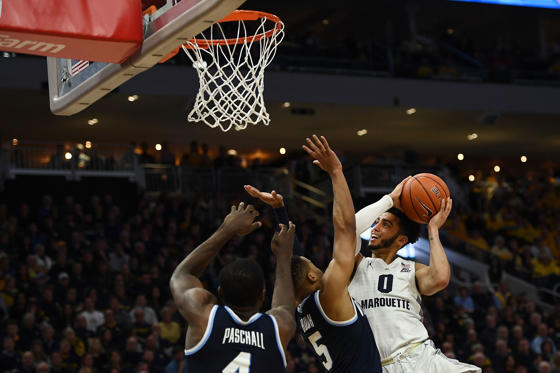 MILWAUKEE, WISCONSIN - FEBRUARY 09:  Markus Howard #0 of the Marquette Golden Eagles drives to the basket against Phil Booth #5 of the Villanova Wildcats during the first half at Fiserv Forum on February 09, 2019 in Milwaukee, Wisconsin. (Photo by Stacy Revere/Getty Images)