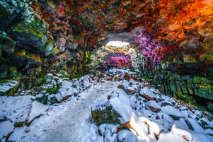 The lava cave has a special landscape and a multi-layered colour covering the snow and moss lava. Very spectacular and beautiful.