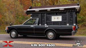 a truck is parked in front of a car: Toyota Crown Hearse For Sale On eBay