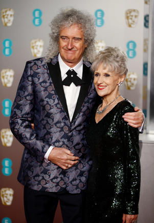 Anita Dobson and Brian May arrive at the British Academy of Film and Television Awards (BAFTA) at the Royal Albert Hall in London, Britain, February 10, 2019. REUTERS/Henry Nicholls