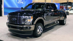 a car parked in front of a truck: 2020 Ford Super Duty Live