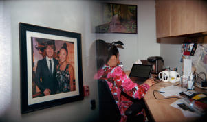 TORONTO, ON - APRIL 25: A photograph of Tom Cruise and Elaine Lui hangs in the hallway of Bell Media Studios. Elaine Lui finishes a daily email to subscribers of her site, laineygossip.com in her office immediately after taping The Social and etalk in Toronto on April 25, 2018. (Photo by Sarah Palmer for The Washington Post via Getty Images)