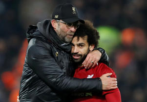 Liverpool manager Juergen Klopp celebrates with Mohamed Salah