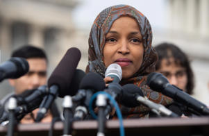 US Representative Ilhan Omar, Democrat of Minnesota, speaks during a press conference calling on Congress to cut funding for US Immigration and Customs Enforcement (ICE) and to defund border detention facilities, outside the US Capitol in Washington, DC, February 7, 2019. (Photo by SAUL LOEB / AFP)        (Photo credit should read SAUL LOEB/AFP/Getty Images)