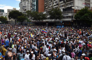 Venezuelan opposition supporters take to the streets to protest against the government of President Nicolas Maduro, on the anniversary of 1958 uprising that overthrew military dictatorship in Caracas on January 23, 2019. - At least four people died in overnight clashes in Venezuela as opposition supporters and regime loyalists prepared for rival rallies Wednesday, in the wake of a failed military mutiny against President Nicolas Maduro. (Photo by YURI CORTEZ / AFP)        (Photo credit should read YURI CORTEZ/AFP/Getty Images)