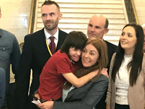 Billy Caldwell and his mother Charlotte (centre)