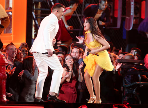 "Slide 1 of 41: Ricky Martin, left, and Camila Cabello perform ""Havana"" at the 61st annual Grammy Awards on Sunday, Feb. 10, 2019, in Los Angeles. (Photo by Matt Sayles/Invision/AP)"