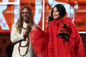 "Kacey Musgraves accepts the award for Best Country Album with ""Golden Hour"" during the 61st Annual Grammy Awards on February 10, 2019, in Los Angeles. (Photo by Robyn Beck / AFP)        (Photo credit should read ROBYN BECK/AFP/Getty Images)"