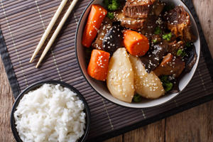 Galbi jjim Korean Braised Beef Short Ribs with rice close-up on the table. Horizontal top view from above
