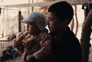 A still from an IS propaganda film that shows children training for combat