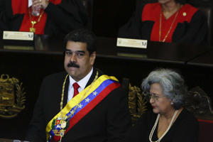 CARACAS, VENEZUELA - JANUARY 24: President of Venezuela Nicolás Maduro (L) looks on before talking to judges and members of the Supreme Justice Tribunal on its annual opening day of sessions on January 24 in Caracas, Venezuela. Yesterday opposition leader and head of the National Assembly Juan Guaidó declared self interim president. Several countries including US, France and Brazil accepted Guaidó as the legitimate temporary ruler of the country. In response, Nicolás Maduro urged American diplomats to leave Venezuela in 72 hours breaking diplomatic relationships.  (Photo by Getty Images/Getty Images)