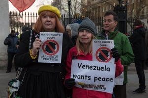 LONDON, UNITED KINGDOM - JANUARY 28: Campaigners from 'Hands Off Venezuela' stage a protest outside Downing Street in central London demanding that the UK government doesn't recognise presidency of Juan Guaido and that the Bank of England gives president Nicolas Maduro access to $1.2 billion Venezuelan gold reserves it holds. The protesters oppose the recognition of Juan Guaido, who proclaimed himself a president on the 23rd of January, by the US, Canada, Israel and Organisation of American States and demand that Venezuelan people should ultimately choose their president. January 28, 2019 in London, England. (Photo credit should read Wiktor Szymanowicz / Barcroft Media via Getty Images)