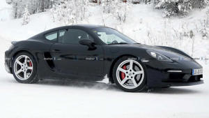 a car parked on the side of a snow covered road: Porsche 718 Cayman GT4 Touring Spy Shots