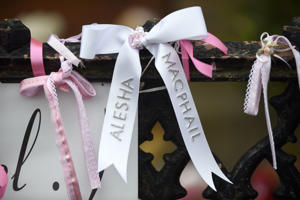COATBRIDGE, UNITED KINGDOM - JULY 21: White and pink ribbons left outside the funeral of six-year-old Alesha MacPhail at the Coats Funeral Home on July 21, 2018 in Coatbridge, Scotland.  Alesha MacPhail's body was found on the Isle of Bute earlier this month.  A 16 year old male is charged with the rape and murder. (Photo by Lesley Martin - WPA Pool/Getty Images)