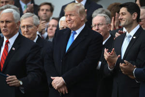 WASHINGTON, DC - DECEMBER 20:  U.S. President Donald Trump, flanked by Republican lawmakers, celebrates Congress passing the Tax Cuts and Jobs Act on the South Lawn of the White House on December 20, 2017 in Washington, DC. The tax bill is the first major legislative victory for the GOP-controlled Congress and Trump since he took office almost one year ago.  (Photo by Chip Somodevilla/Getty Images)
