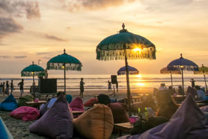 Sunset scene of Seminyak Beach Bali, Indonesia. Features a relaxed coastal ambiance.