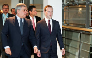 BRUSSELS, BELGIUM - MAY 22: (----EDITORIAL USE ONLY  MANDATORY CREDIT - 'EUROPEAN PARLIAMENT / HANDOUT' - NO MARKETING NO ADVERTISING CAMPAIGNS - DISTRIBUTED AS A SERVICE TO CLIENTS----) Facebook co-founder, Chairman and CEO Mark Zuckerberg (R) walks with President of the European Parliament, Antonio Tajani (L) before testifying to the European Parliament in Brussels, Belgium on May 22, 2018. (Photo by European Parliament / Handout/Anadolu Agency/Getty Images)
