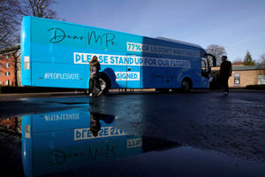 Students at Liverpool's Hope University sign the Our Future, Our Choice, battle bus as activists from the youth movement for a People's Vote tour the north-west