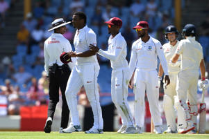 GROS ISLET, SAINT LUCIA - FEBRUARY 11:  Shannon Gabriel (L) of the West Indies is ushered away by Kraigg Brathwaite of the West Indies after confronting Joe Root and Joe Denly of England during Day Three of the Third Test match between the West Indies and England at Darren Sammy Cricket Ground on February 11, 2019 in Gros Islet, Saint Lucia. (Photo by Shaun Botterill/Getty Images)