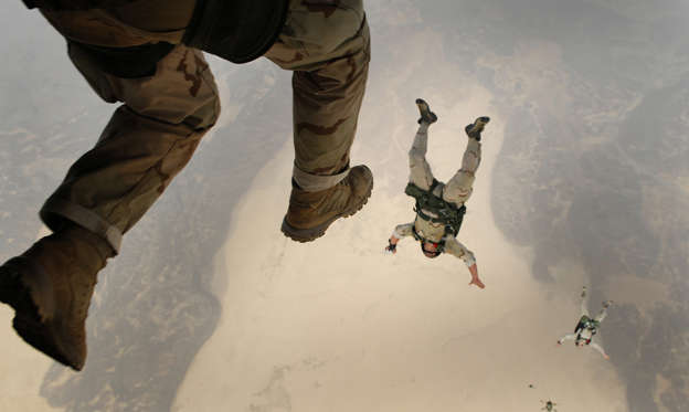 Slide 1 of 48: U.S. Air Force pararescuemen leap from a CH-53 Sea Stallion helicopter during a training mission over Djibouti in this June 9, 2008 picture.