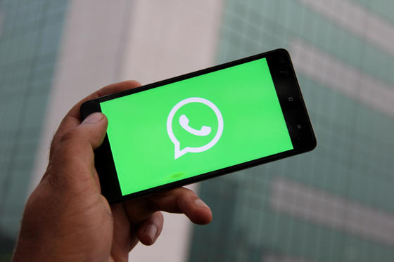 Slide 1 of 16: A Logo of WhatsApp is seen on a phone. WhatsApp to take immediate steps to contain fake news and misuse of its platform.  (Photo by Nasir Kachroo/NurPhoto via Getty Images)