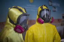 Two yellow Tyvek suits worn by Bryan Cranston and Aaron Paul in the AMC series 'Breaking Bad' are displayed at the National Museum of American History in Washington, DC, November 10, 2015, during a memorabilia donation ceremony.      AFP PHOTO / JIM WATSON        (Photo credit should read JIM WATSON/AFP/Getty Images)