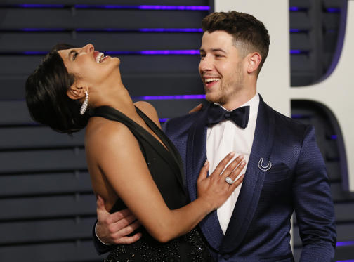 Slide 1 of 25: 91st Academy Awards – Vanity Fair – Beverly Hills, California, U.S., February 24, 2019 – Priyanka Chopra  and Nick Jonas. REUTERS/Danny Moloshok