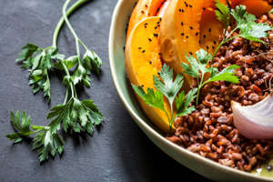 A wholesome bowl of vibrant roast vegetables and curry with Hyacinth beans and red rice.