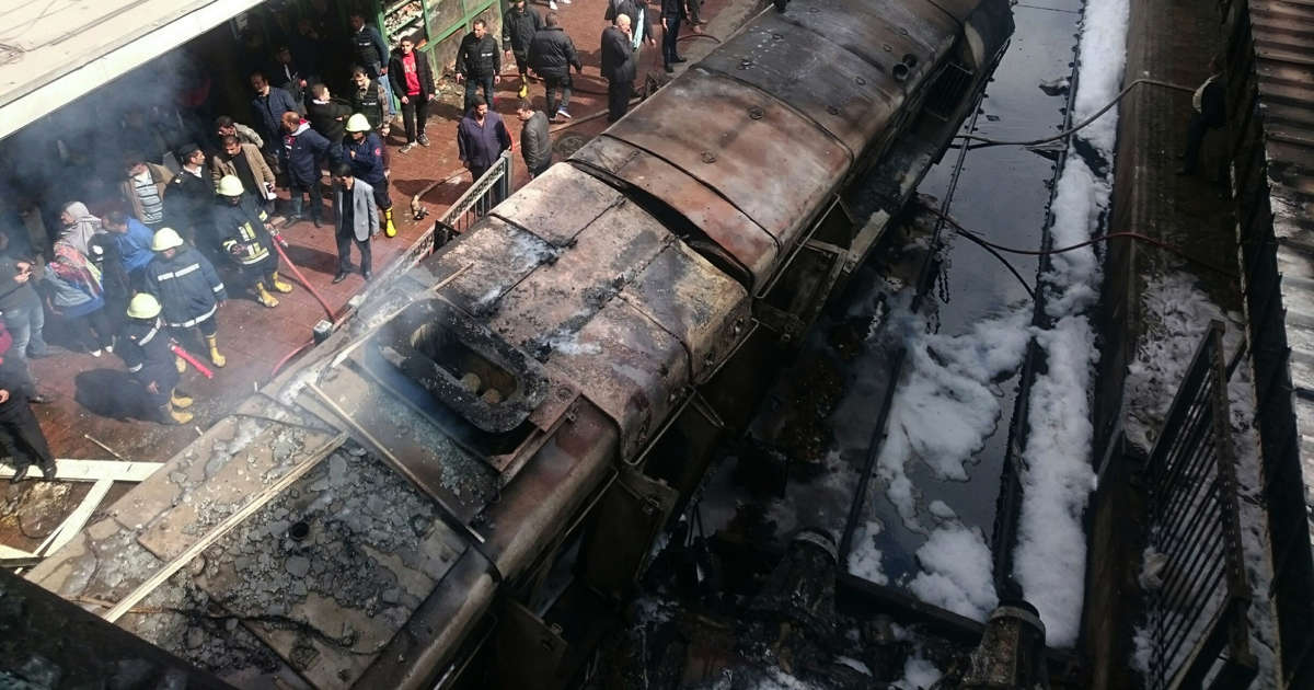 UPDATE 3-Dozens killed and injured in crash and fire at Cairo train station