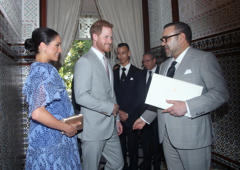 Britain's Meghan, Duchess of Sussex and Prince Harry the Duke of Sussex meet with Moroccan King Mohammed VI at his residence in Rabat, Morocco February 25, 2019. Yui Mok/Pool via REUTERS