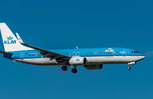 Zurich, Switzerland - September 8, 2018: A KLM Boeing 737-8K2 in sunny autumn weather landing on runway 14 of Zurich Airport. The aircraft registered PH-BCE was delivered to the Dutch airline on April 28, 2014. The photo was taken outside the airport.