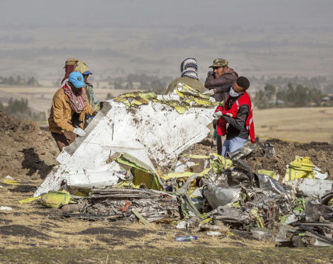 Slide 1 of 53: Rescuers work at the scene of an Ethiopian Airlines flight crash near Bishoftu, or Debre Zeit, south of Addis Ababa,  Ethiopia, Monday, March 11, 2019.
