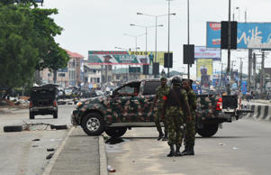 File Photo-Soldiers block with a truck the road leading to the state headquarters of Independent National Electoral Commission (INEC) in Port Harcourt, Rivers State