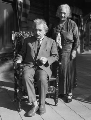 (Original Caption) 1/1932-CA: Professor and Mrs. Einstein are shown in California. He is seated while she stands behind him.