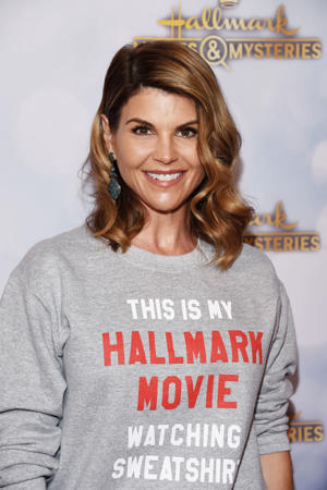 Actress Lori Loughlin arrives at the Hallmark Channel 'Once Upon A Christmas Miracle' screening and holiday party at 189 by Dominique Ansel on December 4, 2018 in Los Angeles, California.  (Photo by Amanda Edwards/Getty Images)