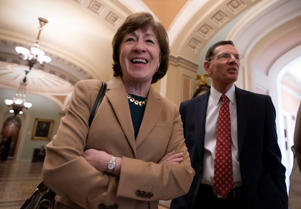 Sen. Susan Collins, R-Maine, joined by Sen. John Barrasso, R-Wyo., smiles as the Senate passed a resolution to terminate President Trump's declaration of an emergency at the Southern border, at the Capitol in Washington, Thursday, March 14, 2019. (AP Photo/J. Scott Applewhite)