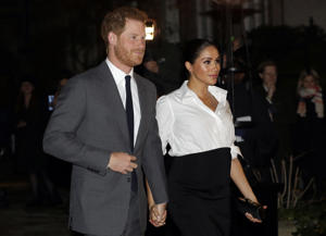 Britain's Prince Harry and Meghan, Duchess of Sussex arrive at the annual Endeavour Fund Awards in London, Thursday, Feb. 7, 2019. The awards celebrate the achievements of service personnel who were injured in service and have gone on to use sport as part of their recovery and rehabilitation. (AP Photo/Kirsty Wigglesworth)