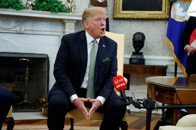 Associated Press    The Latest: Trump's reaction to Senate vote? 'VETO!'  BBUMyUd
