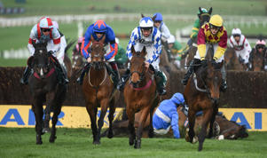 Cheltenham , United Kingdom - 14 March 2019; A view of runners and riders on the first time round including eventual winner Siruh Du Lac, with Lizzie Kelly up, right, and faller King's Odyssey, with Adam Wedge up, the Brown Advisory & Merriebelle Stable Plate Handicap Chase on Day Three of the Cheltenham Racing Festival at Prestbury Park in Cheltenham, England. (Photo By David Fitzgerald/Sportsfile via Getty Images)