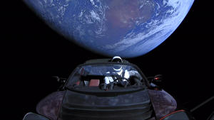 IN SPACE - FEBRUARY 8: In this handout photo provided by SpaceX, a Tesla roadster launched from the Falcon Heavy rocket with a dummy driver named 'Starman'  heads towards Mars. (Photo by SpaceX via Getty Images)