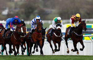 Horse Racing - Cheltenham Festival - Cheltenham Racecourse, Cheltenham, Britain - March 14, 2019   Siruh Du Lac ridden by Lizzie Kelly (R) in action during the 4.10 Brown Advisory & Merriebelle Stable Plate Handicap Chase   REUTERS/Eddie Keogh